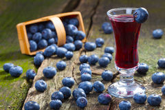 Blueberry liqueur and blueberries Royalty Free Stock Photography