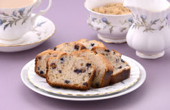 Blueberry loaf slices. With afternoon tea on mauve background Stock Images