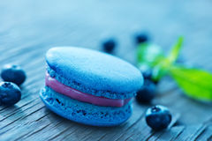 Blueberry macaroon. And berries on a table Stock Image