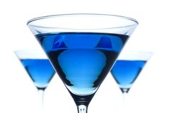 BlueBerry Martini. 3 backlit blue berry martinis in shallow focus stock photography