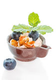 Blueberry and mascarpone dessert in chocolate cup with carameliz Royalty Free Stock Images