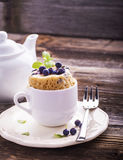 Blueberry Microwave Muffin in mug . Selective focus Stock Photos