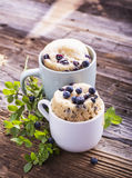Blueberry Microwave Muffin in mug . Selective focus Royalty Free Stock Photo