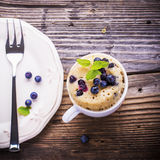 Blueberry Microwave Muffin in mug . Selective focus Stock Photography