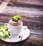 Blueberry Microwave Muffin in mug . Selective focus Royalty Free Stock Images