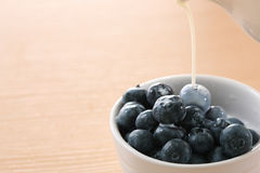 Blueberry and milk Stock Images