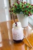 Blueberry milk soda in glass mug Stock Photography