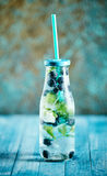 Blueberry and mint drink in bottle royalty free stock photography