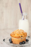 Blueberry Muffin Breakfast with Glass Jug of Milk Royalty Free Stock Photos