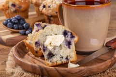 Blueberry Muffin With Butter and Cup of Coffee Royalty Free Stock Image
