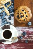 Blueberry muffin and coffee. As breakfast on vintage background, top view royalty free stock image
