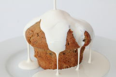 Blueberry Muffin with Cream Pouring Over Royalty Free Stock Photography