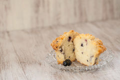 Blueberry Muffin Cut In Half on Glass Plate Stock Photos