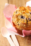 Blueberry muffin on wooden table with spoons Stock Images