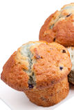 Blueberry muffins. On white plate. Copy space top left corner Stock Photo