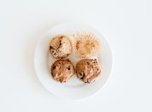 Blueberry muffins and empty muffin case from above Stock Photography