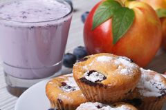 Blueberry muffins, fresh peaches and a milkshake horizontal Stock Photos