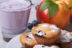 Blueberry muffins, fresh peaches and a milkshake horizontal Stock Photos