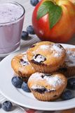 Blueberry muffins, fresh peaches and a milkshake vertical Stock Photography