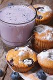 Blueberry muffins and a milkshake with berries vertical Royalty Free Stock Image