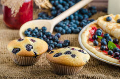 Blueberry muffins and pancakes Stock Images