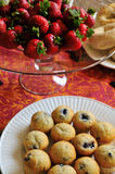 Blueberry muffins and strawberries Stock Photos