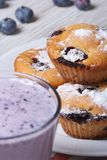 Blueberry muffins on a white plate and berry cocktail vertical Stock Photo