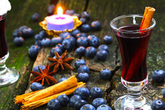 Blueberry mulled wine. With candle Stock Images