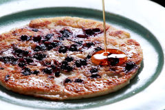 Blueberry pancake poured with maple syrup Royalty Free Stock Photography