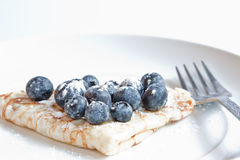 Blueberry Pancakes. Pancake topped with fresh blueberries & dusted with icing sugar Stock Photo