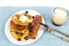 Blueberry Pancakes and Bacon Stock Photo