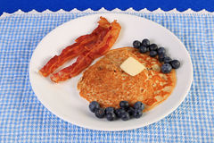 Blueberry Pancakes and Bacon Stock Image