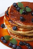 Blueberry pancakes with berries and maple syrup top view Stock Photo