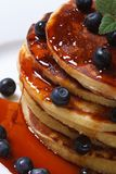 Blueberry pancakes drenched  syrup. Macro top view Stock Photography