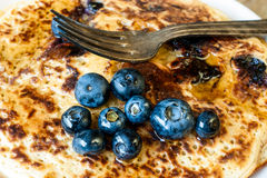 Blueberry pancakes and fork Royalty Free Stock Photo