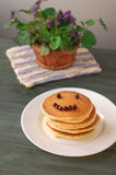 Blueberry pancakes with fresh blueberries Royalty Free Stock Photo
