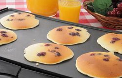 Blueberry pancakes on the grill Stock Photos