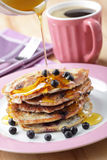 Blueberry pancakes with honey Stock Image