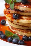 Blueberry pancakes with maple syrup and mint macro Stock Photos