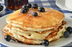 Blueberry pancakes on a picnic table Royalty Free Stock Photos