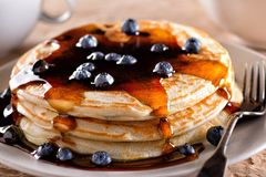 Blueberry Pancakes. A plate of delicious blueberry pancakes with real maple syrup Royalty Free Stock Photo