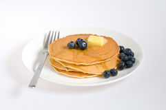 Blueberry pancakes on a plate with fork Stock Photography