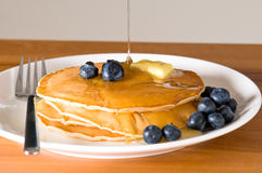 Blueberry pancakes on a plate with fork Royalty Free Stock Photos
