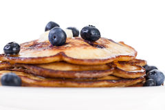 Blueberry Pancakes. Stack of blueberry pancakes with butter and syrup isolated on a white background Stock Image