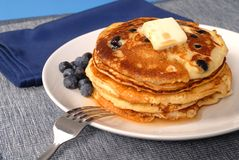 Blueberry pancakes with syrup Stock Images