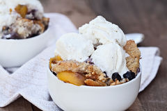 Blueberry and Peach Cobbler with Ice Cream stock photos