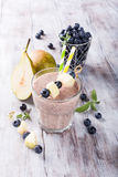 Blueberry and pear smoothie in a glass Stock Images