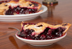 Blueberry Pie. Slice of blueberry pie with the pie in the background Stock Photo