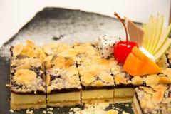 Blueberry pie on a black plate Stock Photos