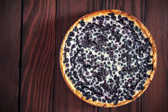 Blueberry pie. On the dark wooden background, top view Stock Photography